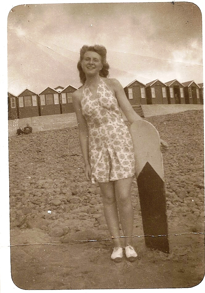 Family snapshot: Most British beaches were closed during WW2 but afterwards holidaymakers soon returned, as seen in this snapshot of a teenager with 'surf rider board', dated 1946. Jayne Shrimpton
