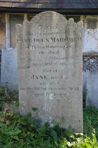 """Mahomed's grave marker in St Nicholas' churchyard. It reads """"Sacred to the memory of SAKE DEEN MAHOMED of Patna Hindoostan who died on the 25th of February 1851 aged 101 years and JANE his wife who died on the 26th of December 1850 aged 70 years. Photo by Tony Mould, printed courtesy of www.mybrightonandhove.org.uk"""